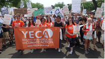 "Young people carry a banner that reads ""Young Evangelicals for Climate Action"" through Wash. D.C."