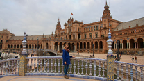 A student stands in front of a landmark in Spain.