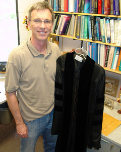 Larry Louters displays William Spoelhof's academic robe.