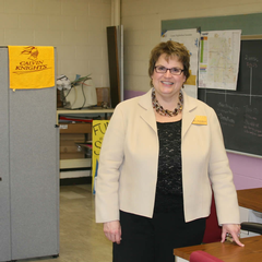 Deb Boosenbroek in Calvin's classroom at St. Alphonsus