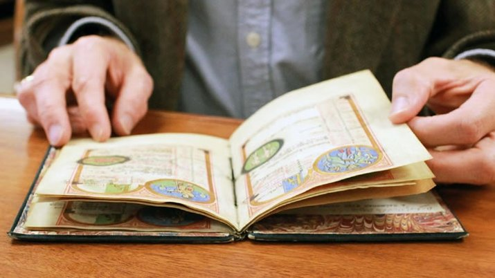 Professor dives deep into history of rare manuscript