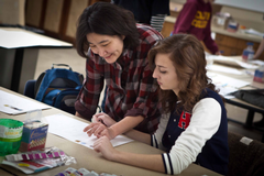Professor You-Kyong Ahn works with junior Mary VanPoolen.