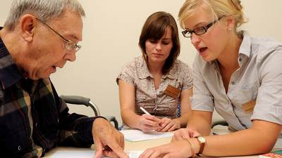 A speech pathology and audiology student working with a client.