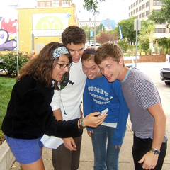 A group of students use the app to navigate ArtPrize.