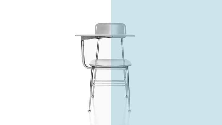 A classroom chair set against a white backdrop.