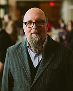 Lew Klatt, Calvin College professor of English and Grand Rapids poet laureate