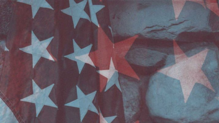 Graphic design of American flag's stars double-exposed on rocks.