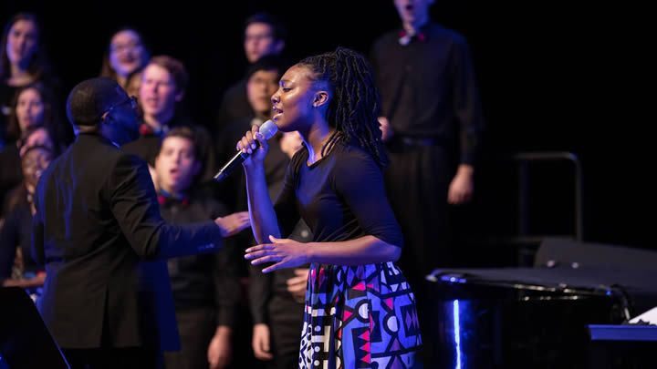 Student at center stage in gospel choir