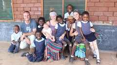 Dana Krol '14, Dave '11 and Jill Honderd Draayer '13 at The Esther School in Chongwe, Zambia