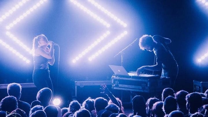 Sylvan Esso performing on stage