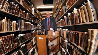 A fisheye view of Dick Harms, Calvin's archivist, in the Hekman library.