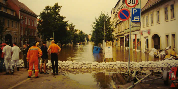 The cleanup effort in Pirna, Germany after the flooding in 2002. (Source: Wikimedia Commons.)