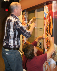 Dean Gunnink and Brian Koster installing an All-American pillar