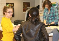 Julia Kimble (far left) works alongside crew members in the costume shop.