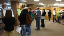 Students viewing posters at CMS 151 Poster session.