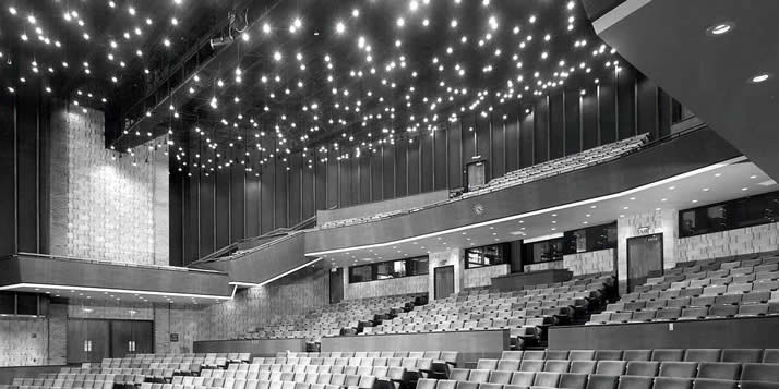 The lights in the FAC auditorium shine brightly one last time.
