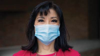 Calvin University professor Pearl Shangkuan wearing a surgical mask
