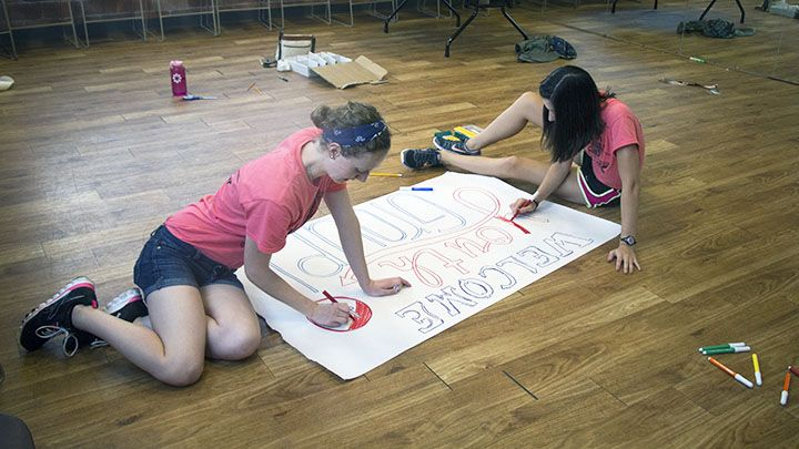 Students drawing poster for local church event