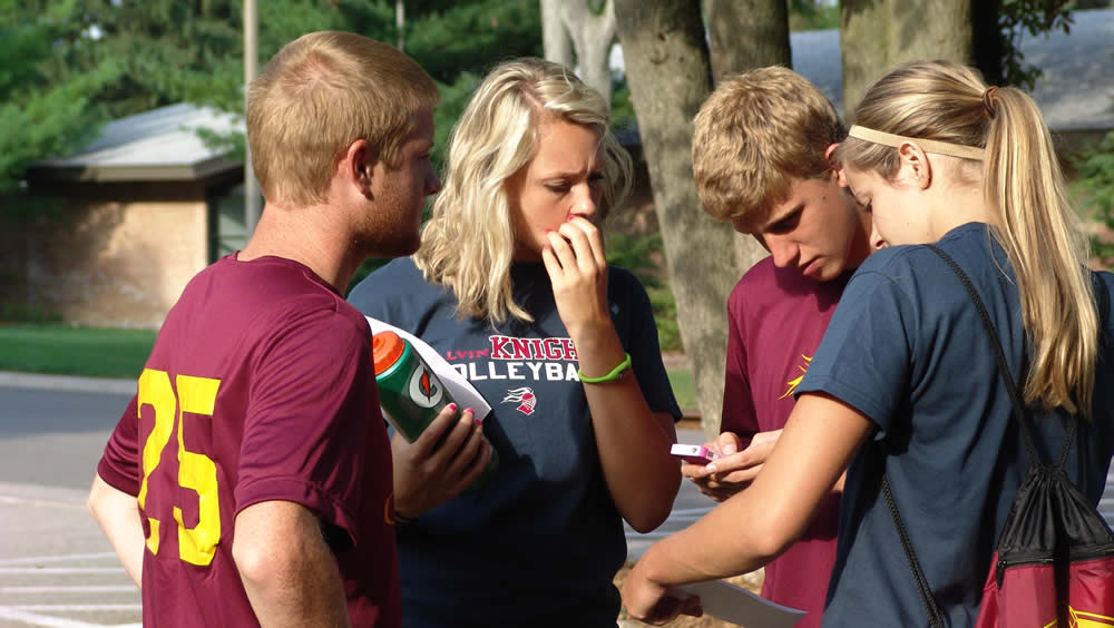 The women's volleyball team and men's soccer team strengthen their bodies and their bond through geocaching.