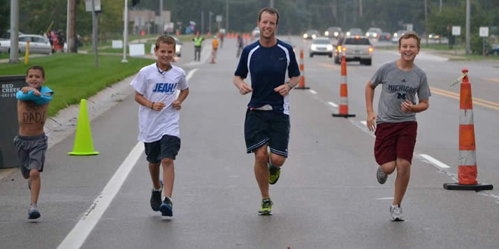Gelderloos' three sons run the final 1/4 mile with their dad.
