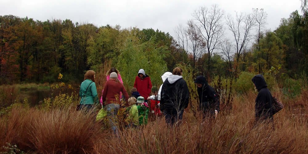 The Bunker Interpretive Center staff teaches families about the native plants and animals of west Michigan.