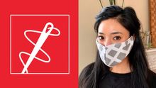 A sewing needle logo next to a photo of a student with a face cloth covering their mouth and nose.