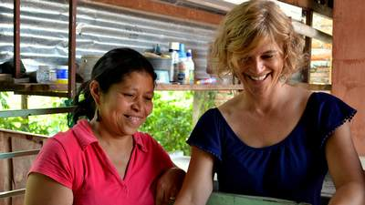 Jo Ann Van Engen '86 working alongside a woman in Honduras.
