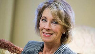 Alumna named education secretary