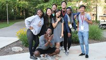 A group of students pose for the camera on a summer day on Calvin's campus.