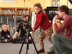 A student at the Mustard Seed School learns to work the camera.