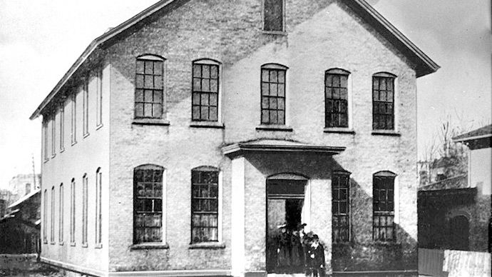 Calvin's first school building founded in 1876.