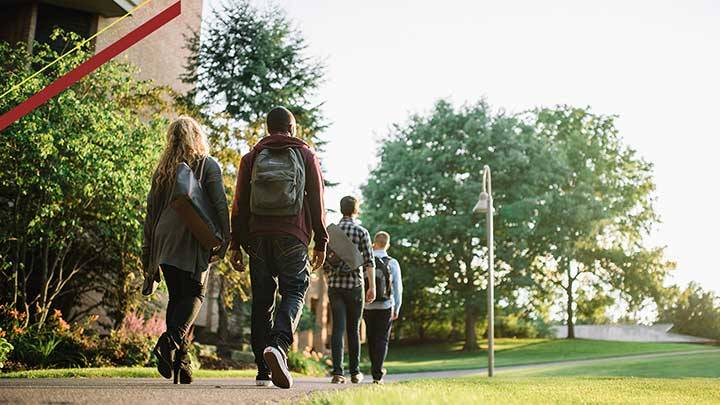 Students walking across campus on their way to classes.