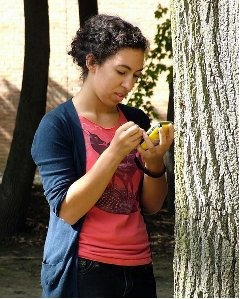 Student mapping trees on campus