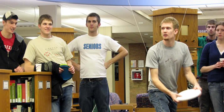 At the annual disc golf tournament, held in the Hekman Library, contestants play a