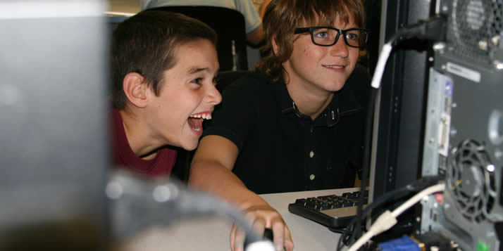 Computer science profs are teaching local middle and high school students programming logic.