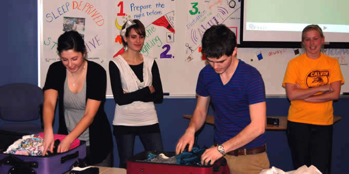 Students compete in a suitcase-packing competition as part of