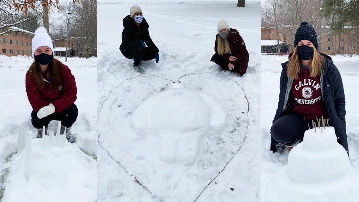 Students with masks creating snow sculptures on university campus.