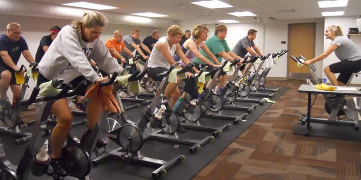 A group of faculty and staff take a 45-minute spin class twice per week.