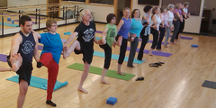 Faculty and staff spend their lunch break doing Yoga.