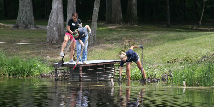 Students trained to lead Streetfest by renovating Calvin's Camp Waltman.