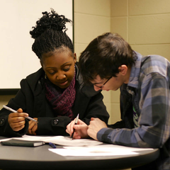 A Calvin student and a local high school student prep for the test.