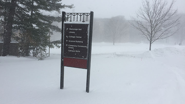 Calvin wayfinding sign stands in wintery conditions.