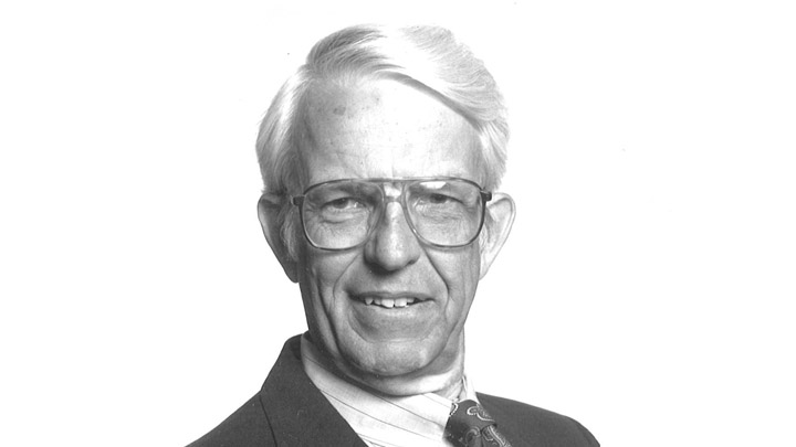 A formal headshot of Calvin professor emeritus Al Bratt