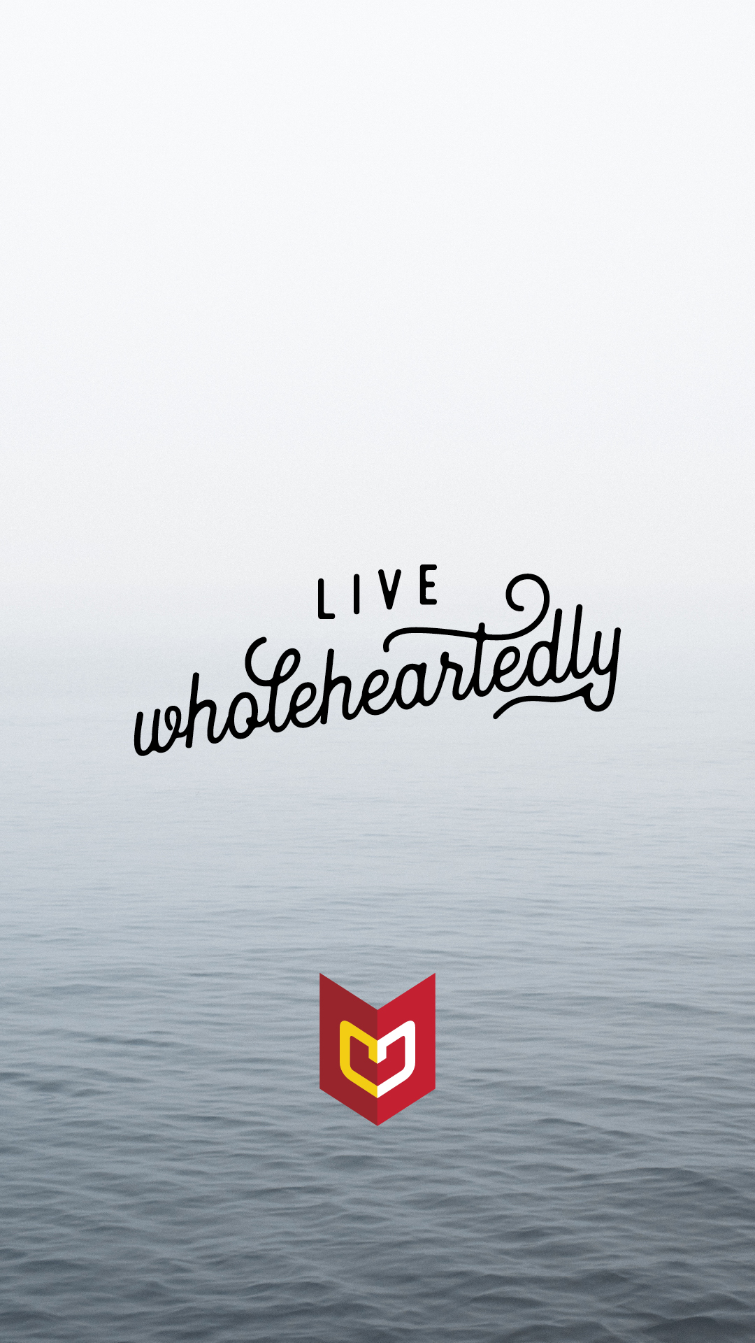 Calm ocean scene with words Live Wholeheartedly