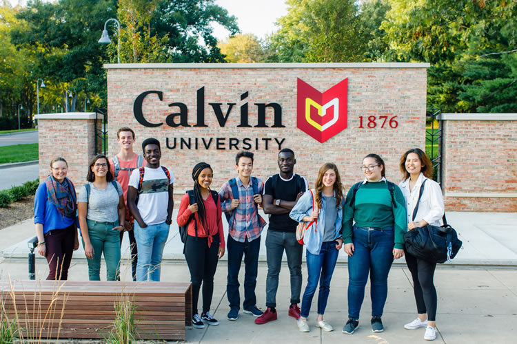 Group of students standing in front of Calvin sign