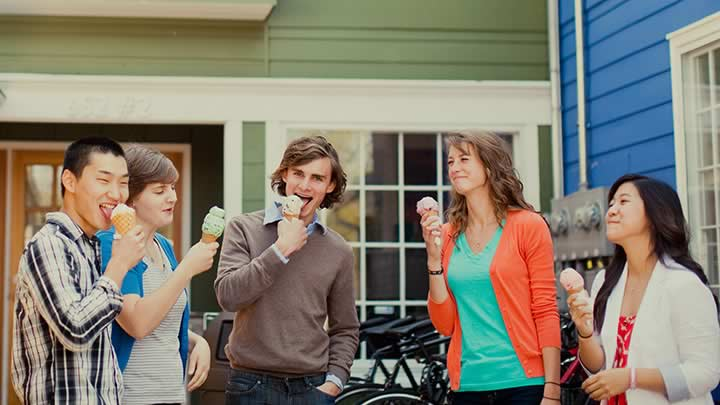 Students eating ice cream outside shop