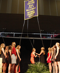 Volleyball team raises championship banner